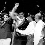 Joe Louis raises his hand in victory after becoming the new world heavyweight champion on June 22, 1937.
