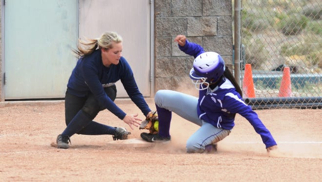 Yerington's Celine Bethel slides safely into third base as Silver Stage's Shawna Peterson tries to make the tag during their doubleheader last Saturday.