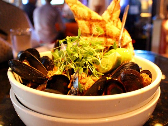 The Choriso Braised mussels are tossed with tomatoes and topped with local micro-greens.