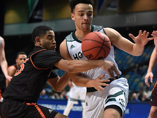 Idaho State's Brandon Boyd, left, and Sacramento State's Marcus Graves battle for a loose ball in the first half of Tuesday afternoon's game the Big Sky Conference Basketball Championships at the Reno Events Center.