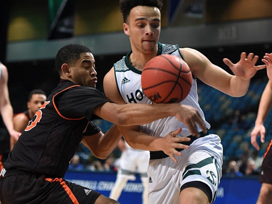 Idaho State's Brandon Boyd, left, and Sacramento State's