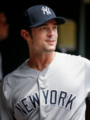 New York Yankees relief pitcher David Robertson enters the dugout for baseball game against the Minnesota Twins, Wednesday, July 19, 2017, in Minneapolis. The Yankees acquired Robertson on Tuesday in a trade with the Chicago White Sox.