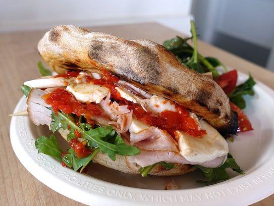 """Pita"" sandwich made with schiacciata, smoked pork"