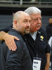 North Farmington's father-son coaching duo of Todd (left) and Tom Negoshian share a moment Friday at the Breslin Center.