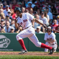 May 24, 2015; Boston, MA, USA; Boston Red Sox shortstop Xander Bogaerts (2) hits a double during the 6th inning against the Los Angeles Angels at Fenway Park. The Red Sox won 6-1. Mandatory Credit: Gregory J. Fisher-USA TODAY Sports ORG XMIT: USATSI-214652 ORIG FILE ID:  20150524_kkt_fb5_166.jpg