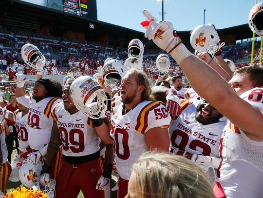 Iowa State players celebrate after an NCAA college