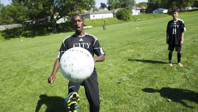 City High's Innocent Mugabo warms up at practice at Longfellow Elementary on Monday. Mugabo has scored four goals and tallied three assists this season