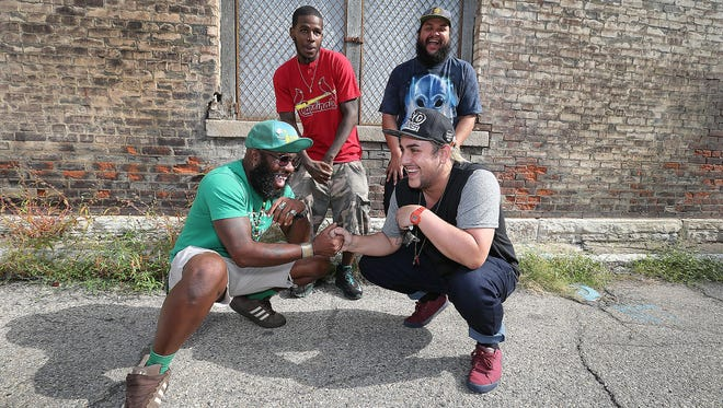 Four Chreece performers (clockwise from bottom left, Ace One, Pope Adrian Bless, Oreo Jones and John Stamps) gather to talk about the inaugural hip-hop festival, scheduled Aug. 29 in Fountain Square.