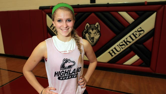 Chelsey Lampe poses for a photo at Highland on Wednesday, Dec. 17, 2014.