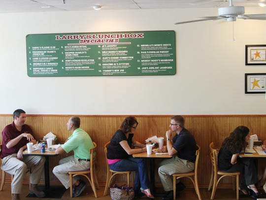 Visitors to Larry's Lunch Box dine at the original