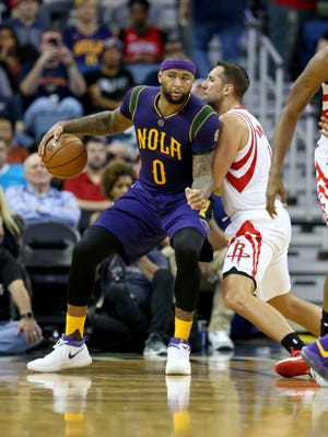 New Orleans Pelicans forward DeMarcus Cousins (0) is defended by Houston Rockets forward Ryan Anderson (3) in the second quarter at the Smoothie King Center.