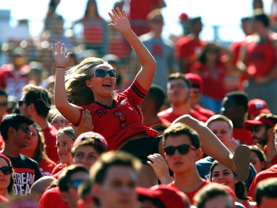 Rutgers fans celebrate a touchdown in the team's win