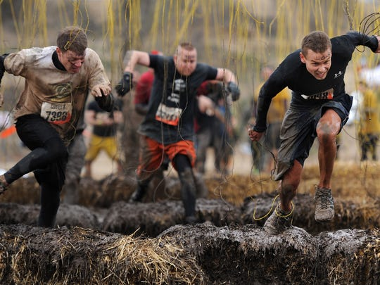The Mudder's Day Run includes 15 obstacles over a 3-mile course. It's the first year for the race, that claims to spare no mud. Shown here is the 2011 Tough Mudder event  in Attica, Ind.