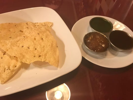 Papadum and an assortment of chutneys at Everest Restaurant in Des Moines.