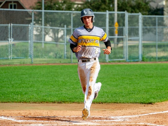 Southeast Polk's Luke Stark crosses the plate in a game last season. Stark, a sophomore, has not given up an earned run in 14 innings pitched this season.