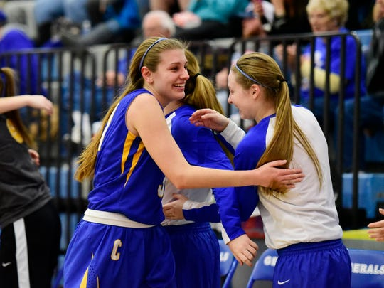 Clyde's Bree Dowling, center, and her teammates celebrate Thursday after beating Lake.