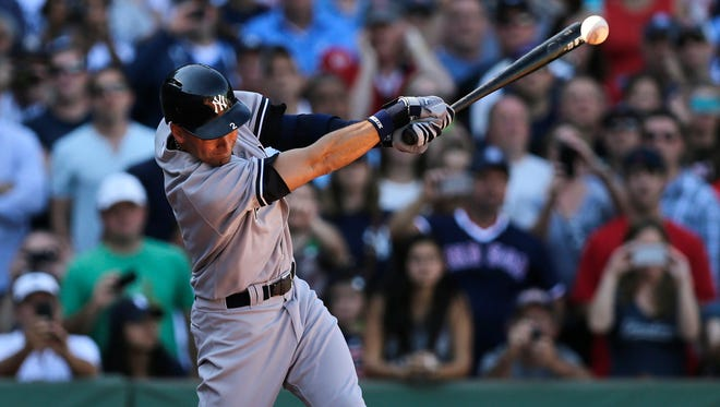 Yankees designated hitter Derek Jeter singles against the Boston Red Sox during the third inning of Saturday's game at Fenway Park.