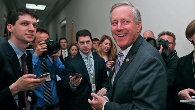 House Freedom Caucus Chairman Rep. Mark Meadows smiles as he speaks to the news media in Washington earlier this year.