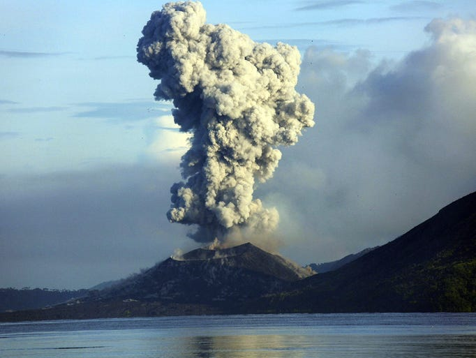 Smoke and ash fills the air as Mount Tavurvur erupts in Rabaul in eastern Papua New Guinea on August 30.