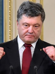 Ukrainian President Petro Poroshenko gestures, during