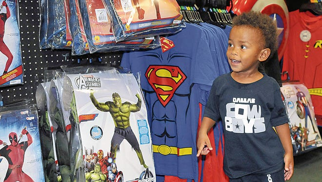 Two-year-old Elijah Bustamante has a big smile on his face as he walks down the super hero aisle at Spirit Halloween Superstore at the Mesilla Valley Mall.