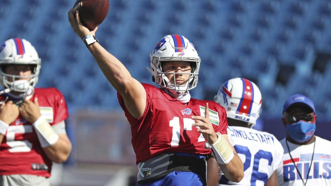Buffalo Bills quarterback Josh Allen, center, throws a pass during training camp in Orchard Park, N.Y., on Aug. 20.  Allen threw for 20 touchdowns with just nine interceptions last season, but his completion percentage was 58.8, ranking 32nd among NFL starters.