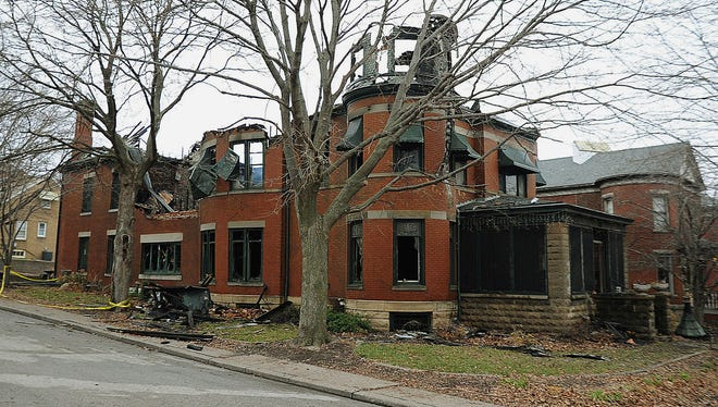 The Huttig mansion, damaged in a Tuesday fire, waits to be demolished in Muscatine, Iowa, Thursday, Dec. 3, 2015. The historic mansion built in 1892.