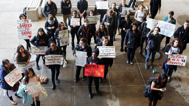 """Protesters gather at Salem City Hall, chanting """"No justice, no peace"""" in the direction of the police department."""