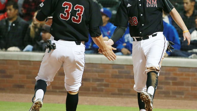 New Mexico State's Joseph Koerper, left, and Cameron Haskins celebrate after scoring Tuesday at Southwest University Park.