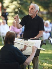 Ted Weaver conducts the Lebanon Community Concert Band at the annual Flag Day ceremony at Fisher Veterans Park in Lebanon on Tuesday, June 14, 2016.