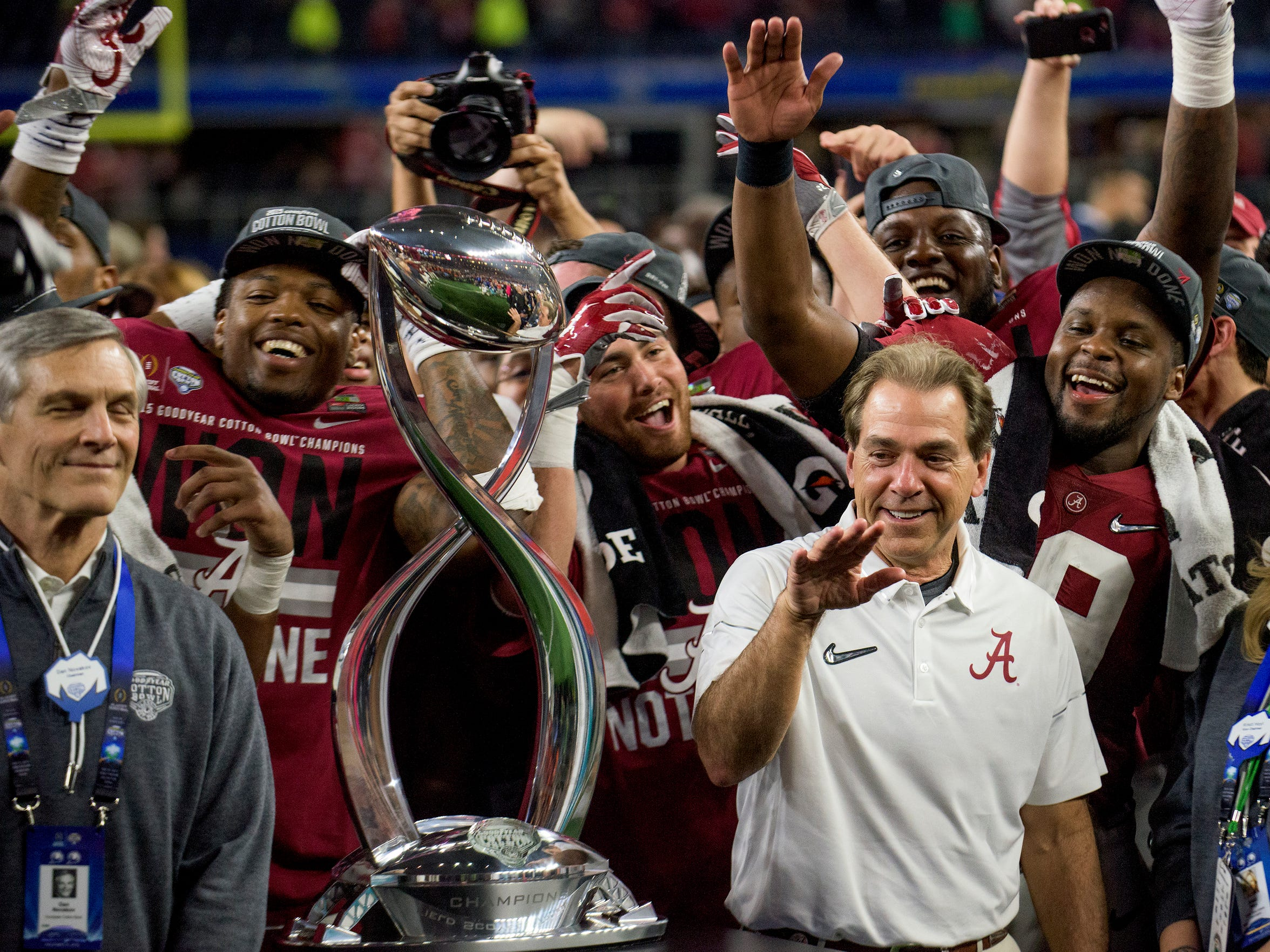 Alabama head coach Nick Saban celebrates with his team after defeating Michigan State in the Cotton Bowl on Thursday December 31, 2015 at AT&T Stadium in Arlington, Tx.