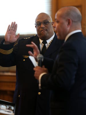 Eliot Isaac is shown during his swearing in as Assistant Police Chief by City Manager Harry Black during a promotion ceremony at City Hall on July 27. On Sept. 9, he was named interim police chief.