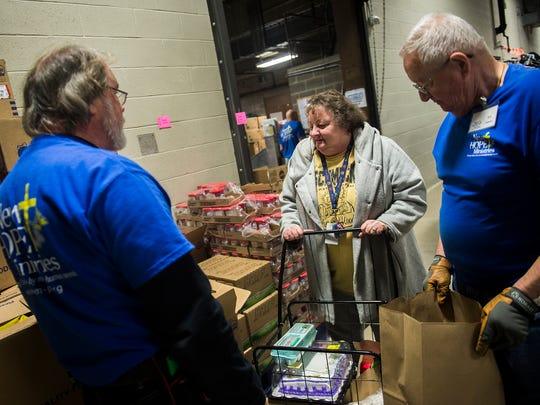 Jody Groft gets assistance from New Hope volunteers