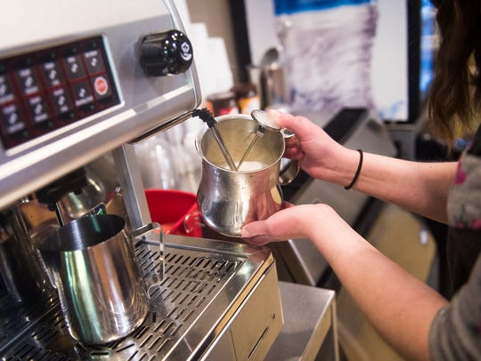 Manager Stephanie Krug steams some milk at Coffee Shop