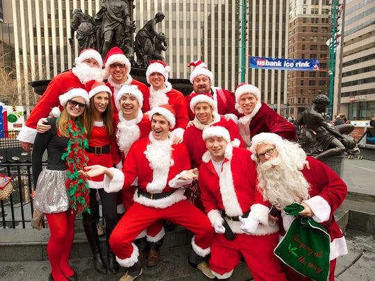 Here comes SantaCon, here comes SantaCon. Santas will be making merry throughout Downtown Saturday.