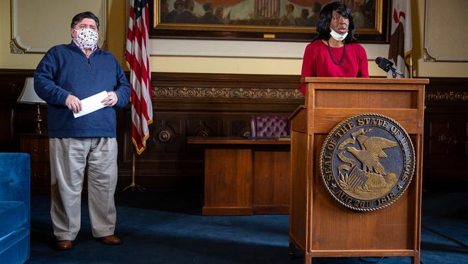 Dr. Ngozi Ezike, director of the Illinois Department of Public Health, delivers the latest numbers for the COVID-19 pandemic during Governor JB Pritzker's daily press briefing on COVID-19 May 21 in his office at the Illinois State Capitol in Springfield.