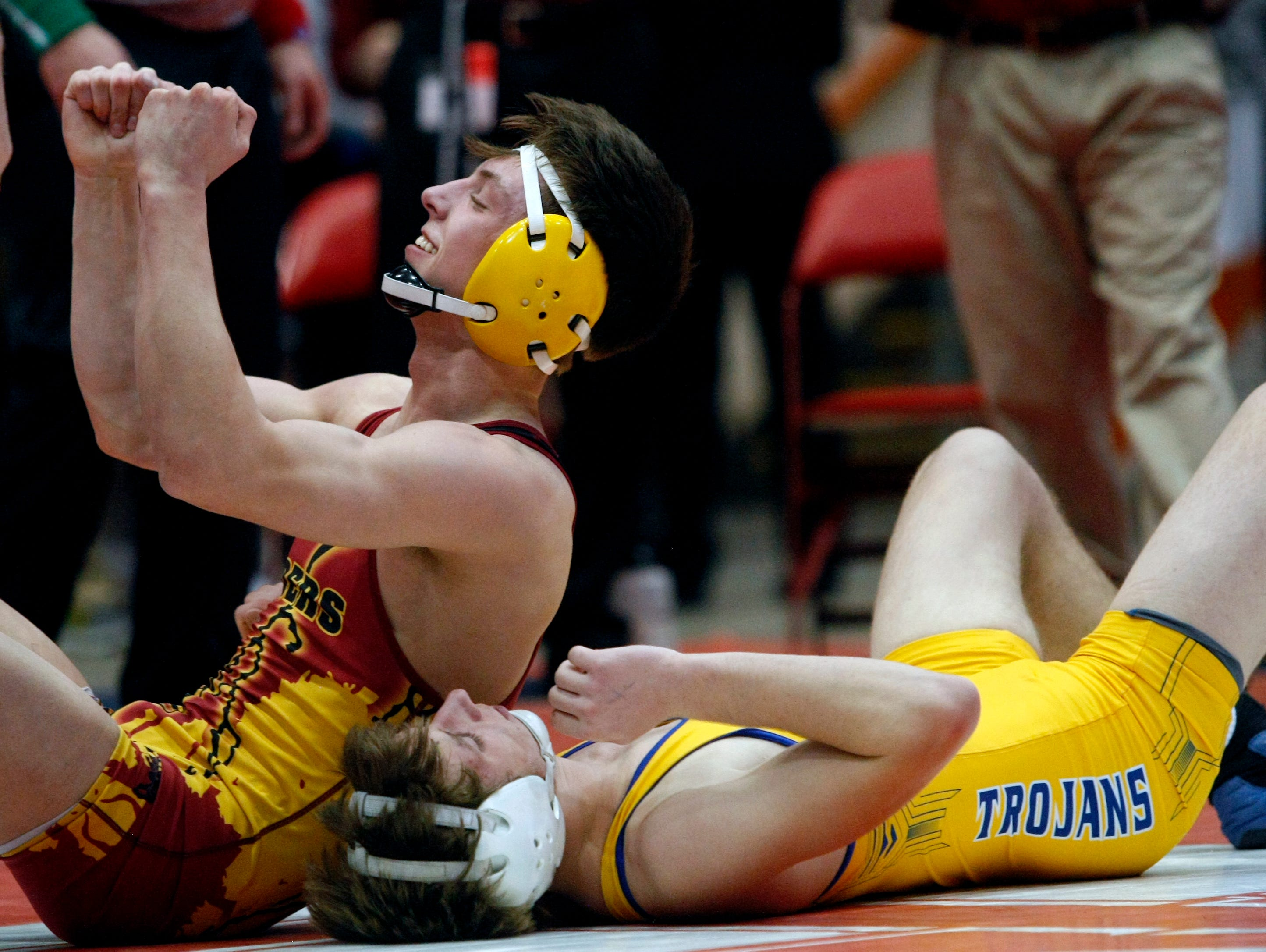 Carter Lohr, Sioux Falls Roosevelt, celebrates after defeating Austin Ideker, of West Central, during the state championship match at 138 pounds Saturday night in Rapid City.