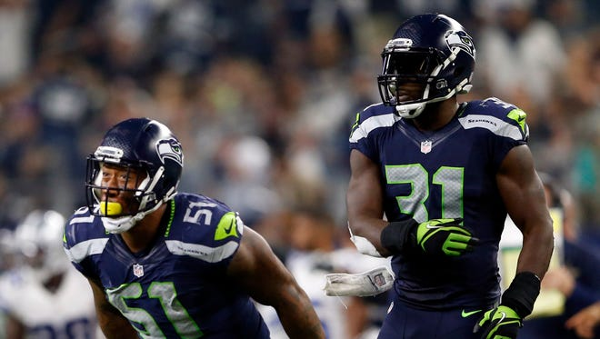 Seattle Seahawks outside linebacker Bruce Irvin (51) reacts after making a sack during the fourth quarter against the Dallas Cowboys at AT&T Stadium.
