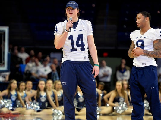 Christian Hackenberg (14) and Jordan Lucas are at the center of  more intense spring practices.