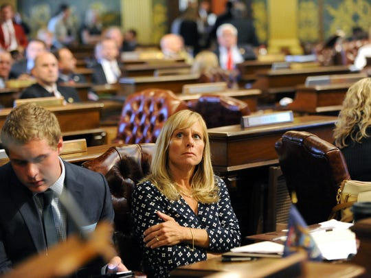 State Rep. Cindy Gamrat watches the votes roll in to expel Gamrat and fellow Rep. Todd Courser in the House of Representatives Thursday 9/10/2015.