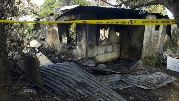 In this file photo,  a house in Chalan Pago house destroyed