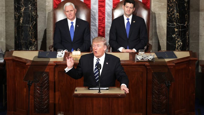 President Donald Trump addresses a joint session of the Congress as Vice President Mike Pence (L) and House Speaker Rep. Paul Ryan (R) (R-WI) look on on February 28, 2017 in the House chamber of  the U.S. Capitol in Washington, DC. Trump's first address to Congress focused on national security, tax and regulatory reform, the economy, and healthcare.