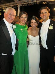 George and Clare Nelson and newlyweds, their daughter,