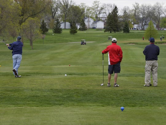 Golfers tee off Tuesday earlier this year at Lakeshore