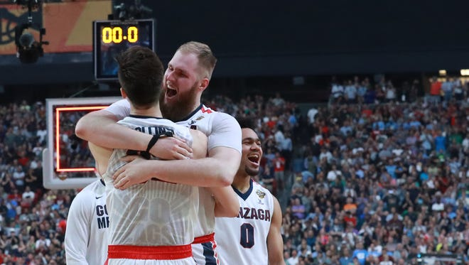 Gonzaga forward Zach Collins (32) and Gonzaga center Przemek Karnowski (24) celebrate winning the NCAA Final Four semifinals against South Carolina at the University of Phoenix Stadium in Glendale, Ariz. on April 1, 2017.