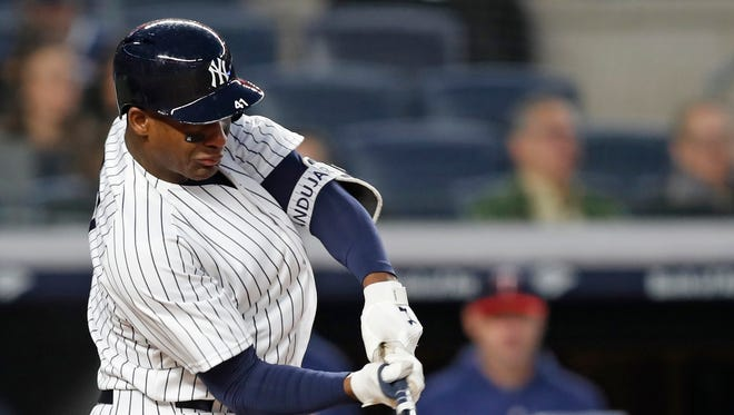 New York Yankees' Miguel Andujar hits a second-inning solo home run during a baseball game against the Minnesota Twins in New York, Monday, April 23, 2018.