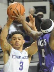 ACU's Tevin Foster (3) looks to pass the ball while