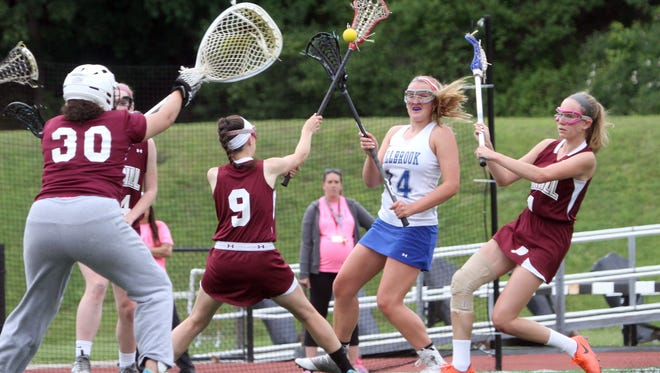 Millbrook's Brooke Babbitt shoots on James O'Neill goalie Caroline Roscoe during the Section 9 Class D girls lacrosse championship at the Newburgh Free Academy May 23, 2017. Millbrook defeated James O'Neill 16-4.