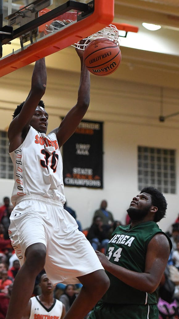 Southside's Jamal Burke (30) dunks over Berea's Jaylan Gordon (34) for two of his 18 points in the Tigers' 49-36 win against the visiting Bulldogs Friday night.