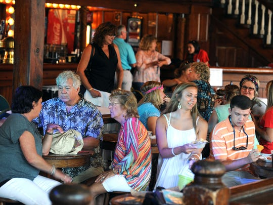 Visitors socialize Saturday during Tarafest at Seville Quarter. All proceeds went to the Tara Blackwell Medical Fund.